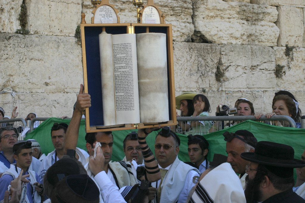 Multiple Bar Mitzvah ceremonies were taking place. Here the Torah is shown aloft after the reading. The men and women are separated by a fence