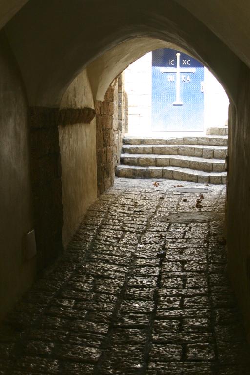 Jaffa walkway. Door at end is to a Greek Orthodox church