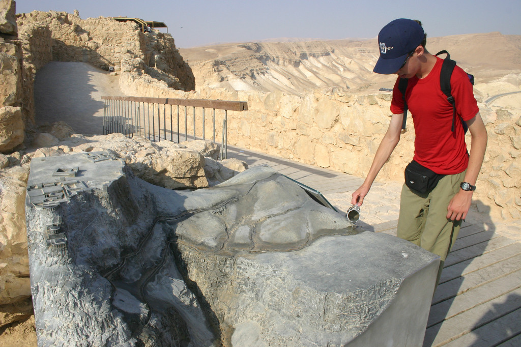"A model of Masada allows us to pour water into a ""wadi"" (storm wash), showing how Herod's engineers funneled water from rare rains into a series of cisterns. So much water was stored that there is a swimming pool on the top!"