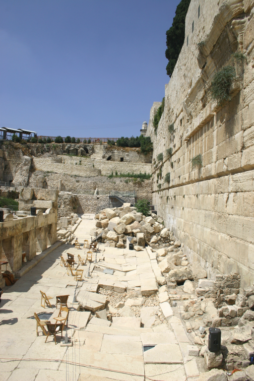 Recent excavation of the part of the western retaining wall just south of THE Western Wall. The road at the base was built by Herod. When the Romans destroyed the city, they tore down the Temple's walls above, pushing huge blocks off of the top, cracking and buckling the road below. Some of the debris and buckling is still visible