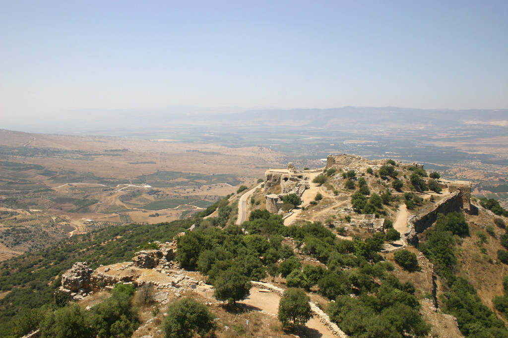 "The view from the main Keep. In foreground, rest of castle. Facing west, in the distance are the hills with the Lebanese border at the top ridge. In the left middle, the elevated Golan Heights, captured by Israel in '67. In the valley between, the Hula valley of Israel, where ""my"" kibbutz is."