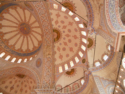 Looking up at the stunning tiled domed ceiling inside the Blue Mosque. Photos don't do it justice.