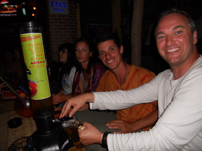 James and Dean get stuck into their beer tower - vacant girl does not share their enthusiasm!
