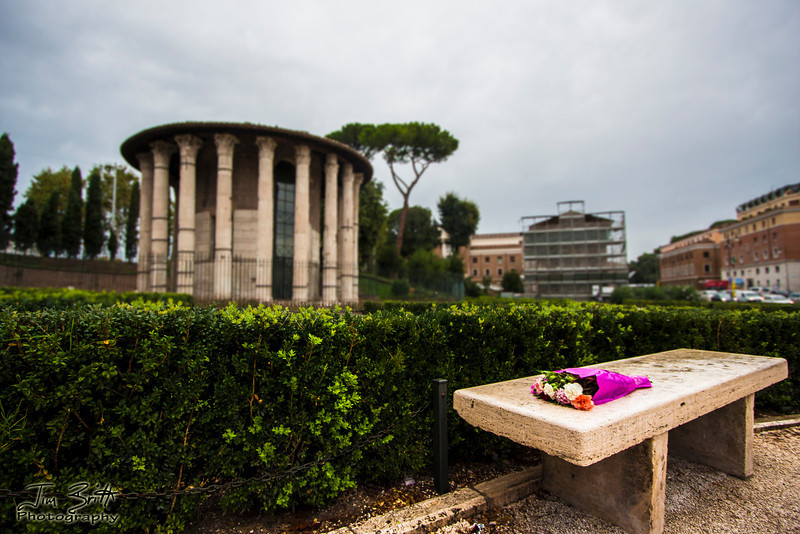 I was touring Rome, Italy with my wife and we came across this display of flowers on a bench.  I made up a story that some romantic guy was waiting here to propose and his to be fiancé never showed and he just left the flowers.  It could happen :).