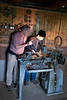 Luigi teaching Nathan how to use a lathe