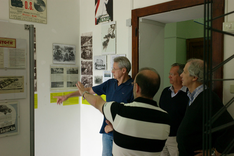 Giovanni, Manfredi, and Luigi with Stefano, museum curator looking at a video