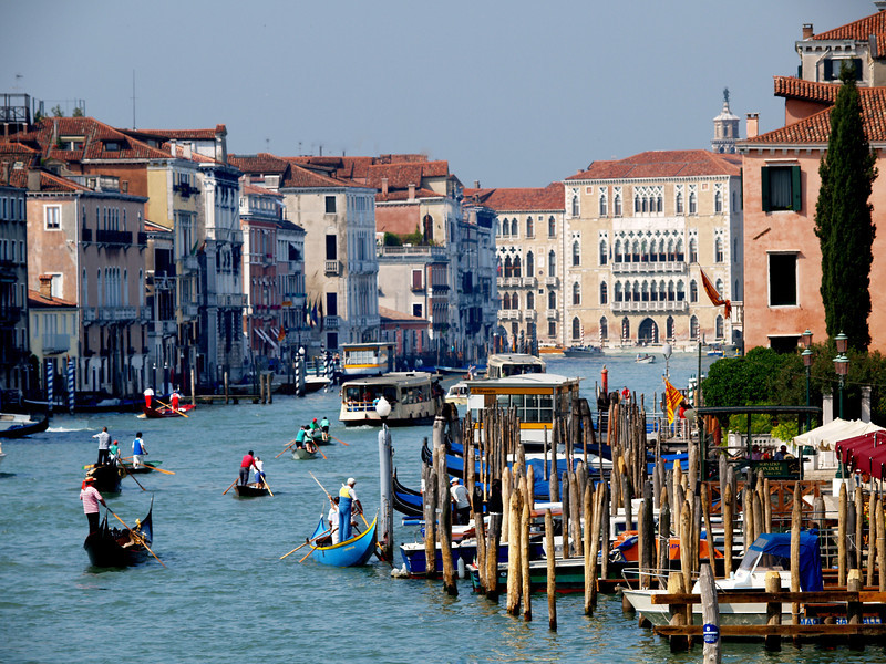 This photograph of the Grand Canal  with its many colorful gondolas and  water front restaurants<br />  was taken from the Rialto Bridge.