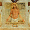 Fresco of Jesus Christ after the crucifixion in a baroque frame on the outside of a wall of a building in Italy