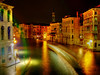 This photograph of the Grand Canal  <br />  was taken late in the evening from the <br /> Rialto Bridge.<br /> <br /> The blurred objects you see on the waterway <br /> are water taxies and gondolas as they navigate <br /> the busy canals.
