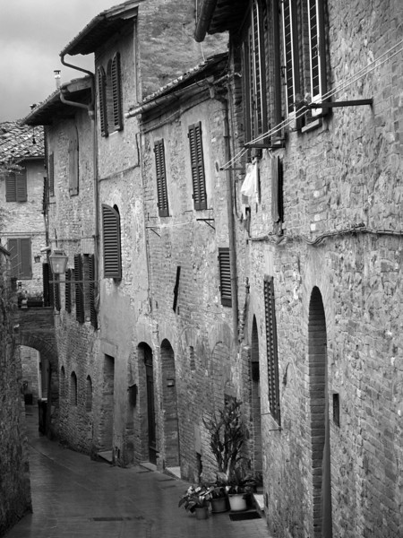 Ancient street in the old hill top<br />  town of San Gimignano in <br /> the Tuscany region of Italy.