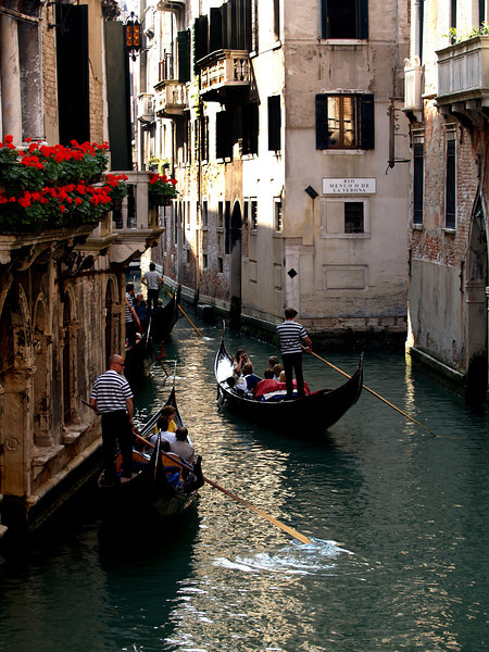 One of the many gondolas in the canals of Venice Italy.