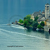 boats take tourists to view an island in the middle of an italian lake (Orta) near milan