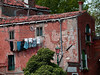 Laundry hanging from an old home in Murano Italy