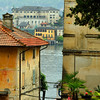 view between buildings old of an italian lake (Orta) near Milan with mountains in the background