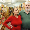 JMag/T. Rob Brown<br /> John and Susie Davidson, owners of Changing Hands Book Shoppe, stand in front of their many shelves of books recently. The store recently celebrated its 20th anniversary.