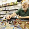 JMag/T. Rob Brown<br /> John Davidson, owner of Changing Hands Book Shoppe, sets up a game session of the popular board game Axis & Allies recently. The store recently celebrated its 20th anniversary.