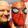 JMag/T. Rob Brown Brad Douglas holds up a Spider-Man bust from his collection.