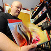 JMag/T. Rob Brown Brad Douglas flips through a Spider-Man book from his Spider-Man collection.