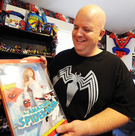 JMag/T. Rob Brown Brad Douglas holds a Mary Jane Barbie doll from his Spider-Man collection.