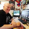 JMag/T. Rob Brown Surrounded by Spider-Man memorabilia in his Spider-Man cave, Brad Douglas laughs after reading a humorous post from a fan in the forums of his famous Spider-Man fan website Spider-Man Crawl Space.