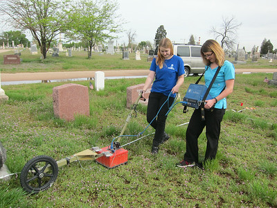 Students from the CU archaeology program scanning the plot.