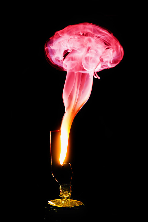 Jan. 11th,  I got home and wanted to try a few more lightbulbs burning out photos.  This is pretty fun, but the action happens so quick.  Breaking the bulbs without breaking the filament is the hardest part.  I did do some color filtering in Photoshop, but I also used a gel over my flash to get some color into the smoke.   Camera settings were F8 at Shutter Speed 1/640th at ISO 200