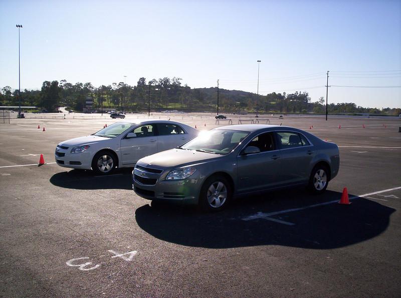 Two Malibu Hybrids on an oval course.