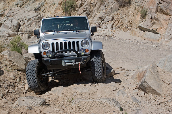 Jeep wrangler climbing out of the wash in Last Chance Canyon in the El Paso Mountains, California. Hehe, I had to let Bill take the wheel of my jeep so I could shoot the group climbing this obstacle. At least he had fun!