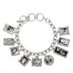 Bracelet_K_03, $58 plus price of charms With this solid sterling silver bracelet, you may choose one charm or as many as you'd like. Each photo is reproduced and sealed on each charm making them waterproof, fadeproof and scratch resistant.