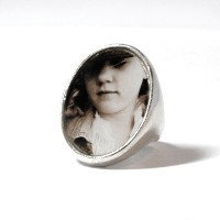 "Ring_K_02, $95.00<br /> This solid sterling oval ring measures 1"" high x 3/4"" wide and is available in size 6, 7 and 8.  Your photo is reproduced and sealed making the photo waterproof, fadeproof & scratch resistant."