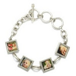 "Bracelet_K_04, starting at $95.00 This sterling silver bracelet is offered with 1-6 photo links, with 1 or 2 sided photos.  Photos are reproduced and sealed making the bracelet waterproof, fadeproof & scratch resistant. Photos measures 7/16"" square."