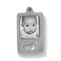 "Charm_K_03, $42.00<br /> Your photo is reproduced and sealed making the charm waterproof, fadeproof and scratch resistant. 3/8""w x 7/16"" h. Solid Sterling Silver."