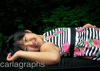 Emma lying on table-