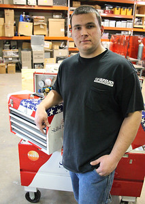 Christopher Kuhn of Sheffield Lake and a former JVS student will compete in Leipzig, Germany as a member of the US World team in the Refrigeration and Air Conditioning competition. He is shown here with his star spangled tool set at the Lorain County Joint Vocational School open house in Oberlin. photo by Ray Riedel