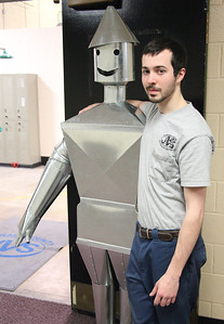 Alexander Ladina of Oberlin poses with the HVAC tinman he built for the Lorain County Joint Vocational School open house in Oberlin. Alexander won a gold medal in Ohio for his skills and qualified for the national Skills USA competition. photo by Ray Riedel