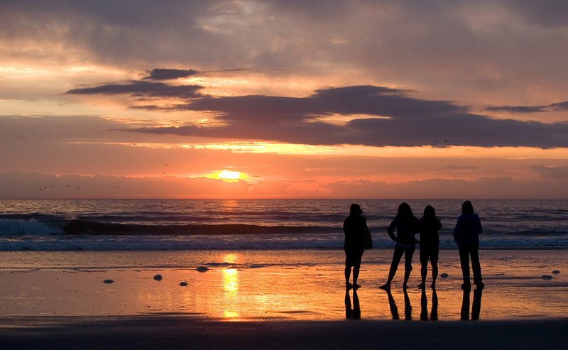 People watching the sunrise near the Jacksonville Beach, Florida Pier