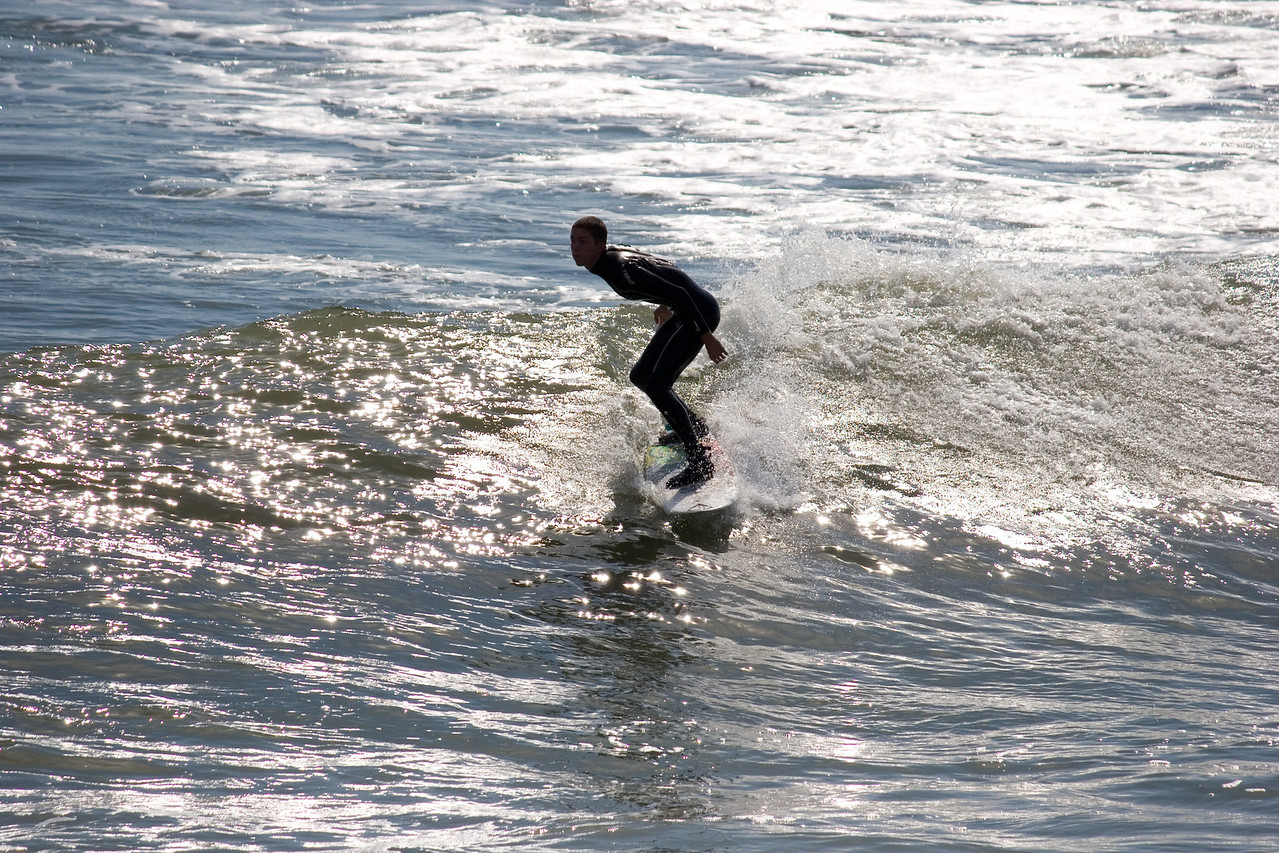 Surfer at the Jax Bch Pier