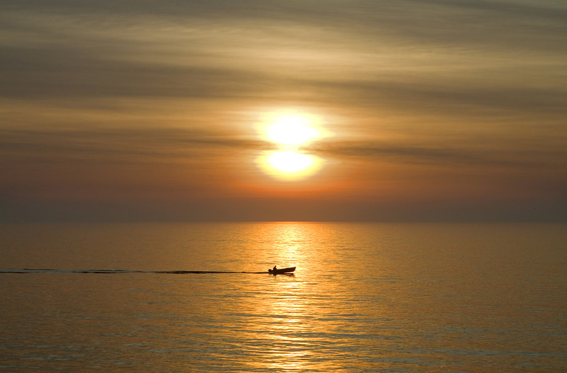Fishing Boat on the Water at Sunrise
