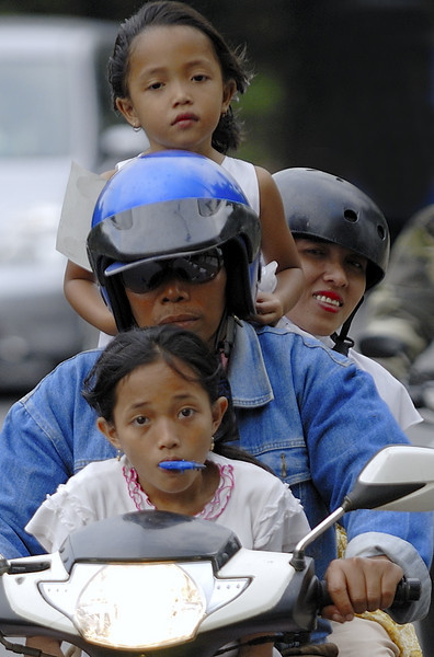 In Jakarta, it is not unusual to see 4-5 people squeezed onto a single small motorcycle.