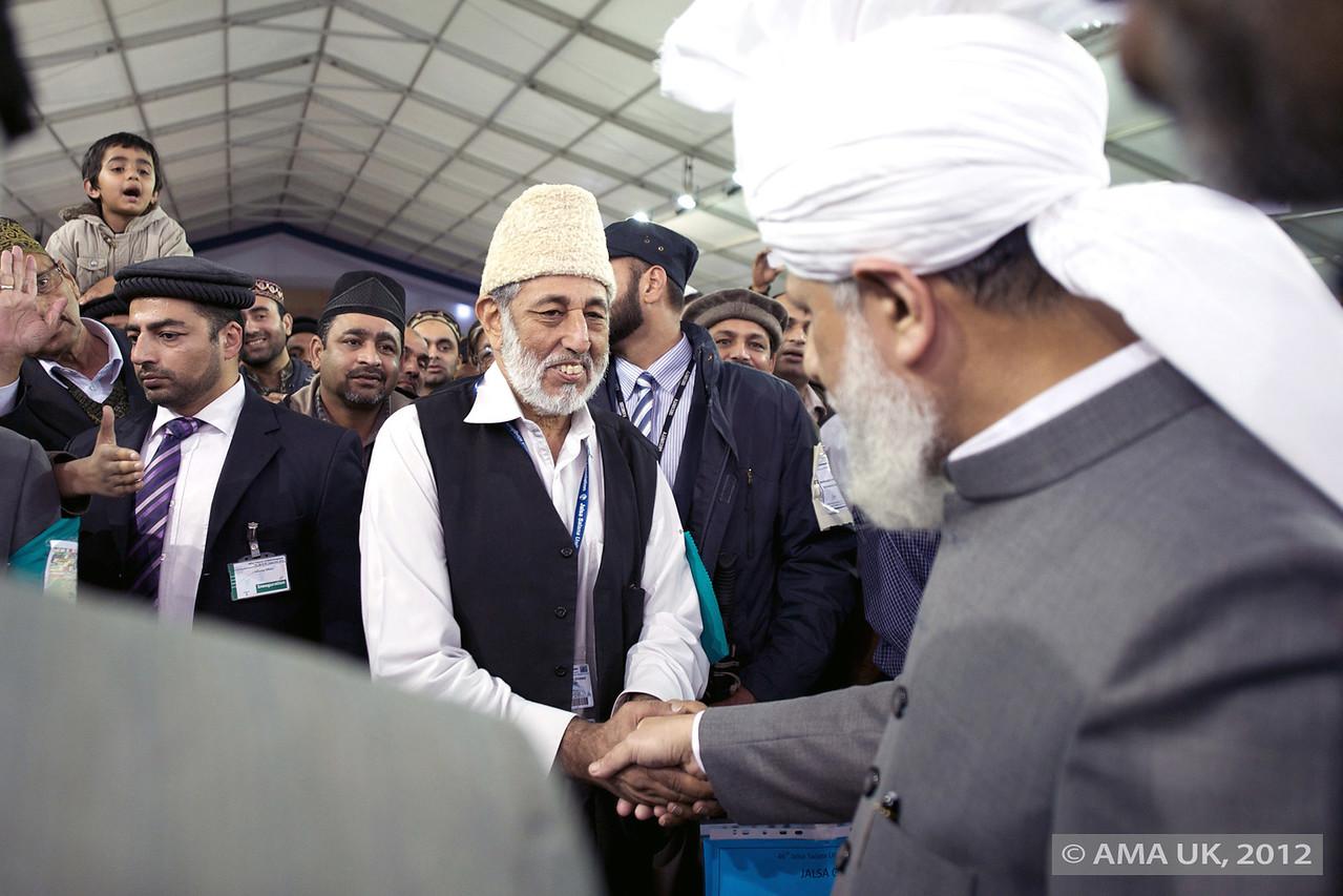 Hudhur Aqdas (atba) greeting Naib Amir Mansoor Shah sahib
