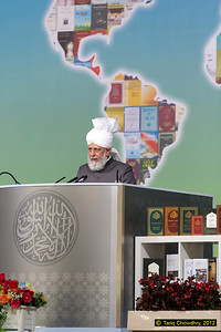 Hudhur Aqdas (atba) delivering his address to delegates at the Jalsa with simultaneous worldwide broadcast through MTA. (Ref 1573)