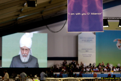 Hudhur Aqdas (atba) delivering his address to delegates at the Jalsa with simultaneous worldwide broadcast through MTA.