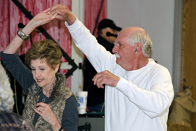 Bill Scherman spins his wife, Celia, at the appreciation dinner for James Frazier in Coalgate on April 11.