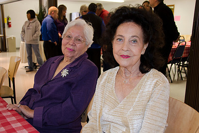 Dellora Miles, left, and Juanita Reid enjoy the company at James Frazier's appreciation dinner in Coalgate on April 11.