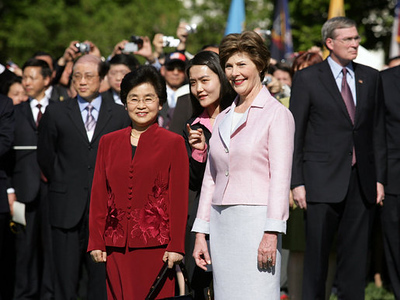 President George W. Bush and Mrs. Laura Bush participate in a South Lawn Arrival Ceremony for the President of the People's Republic of China, Hu Jintao, and Madam Liu Yongqing on the South Lawn