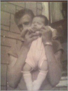 1962 - Uncle Billy Ray Gaines (my mother's brother) holding his brand new niece (me)