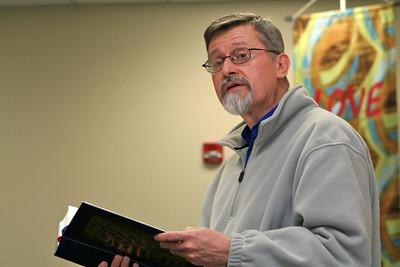 Fr. Ed Zemlik does a read at Wednesday's adoration