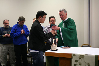 Novice Son Ho assists as a minister of the cup