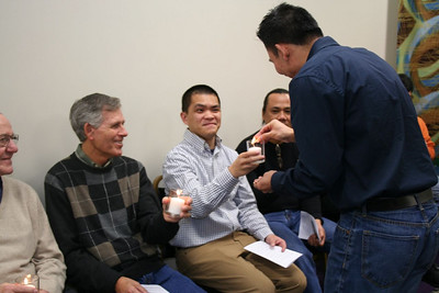 Fr. Vien Nguyen helps to light the candles