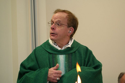Fr. Bob Tucker gives the homily during Wednesday's mass.